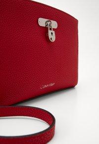 Calvin Klein - DRESSED BUSINESS CROSSBODY - Skulderveske - red - 2