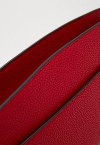 Calvin Klein - DRESSED BUSINESS CROSSBODY - Skulderveske - red - 5
