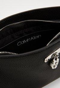 Calvin Klein - DRESSED BUSINESS CROSSBODY - Sac bandoulière - black - 4
