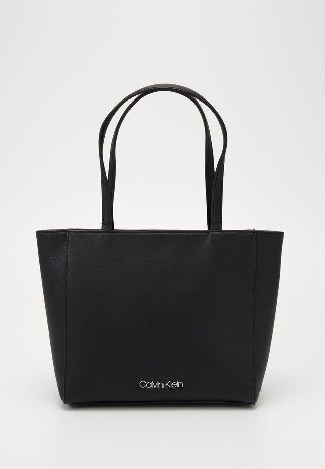 MUST - Handtasche - black