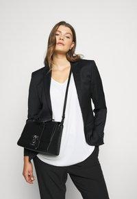 Calvin Klein - DRESSED BUSINESS TOP HANDLE - Handbag - black - 1