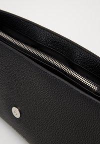 Calvin Klein - DRESSED BUSINESS TOP HANDLE - Handbag - black - 5