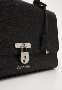 Calvin Klein - DRESSED BUSINESS TOP HANDLE - Handbag - black - 3
