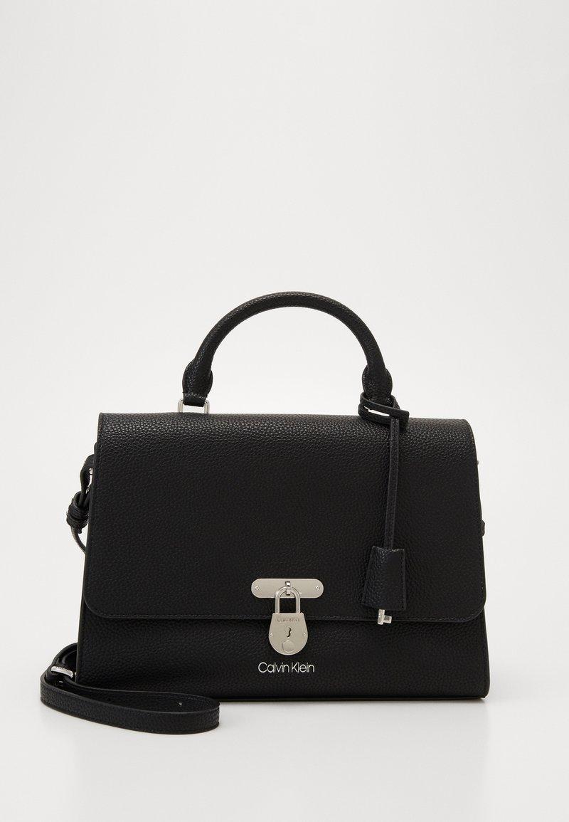 Calvin Klein - DRESSED BUSINESS TOP HANDLE - Handbag - black