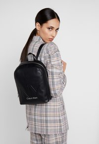 Calvin Klein - SHAPED BACKPACK - Reppu - black - 1
