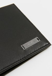 Calvin Klein - SMOOTH PLAQUE SLIMFOLD - Wallet - black - 2