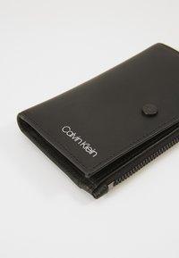Calvin Klein - UNITED COIN - Lompakko - black - 2