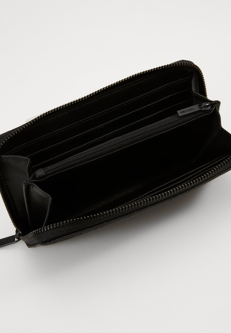 Calvin Klein - MONO BLEND LONG ZIPAROUND - Lompakko - black