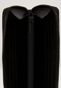 Calvin Klein - MONO BLEND LONG ZIPAROUND - Lompakko - black - 3