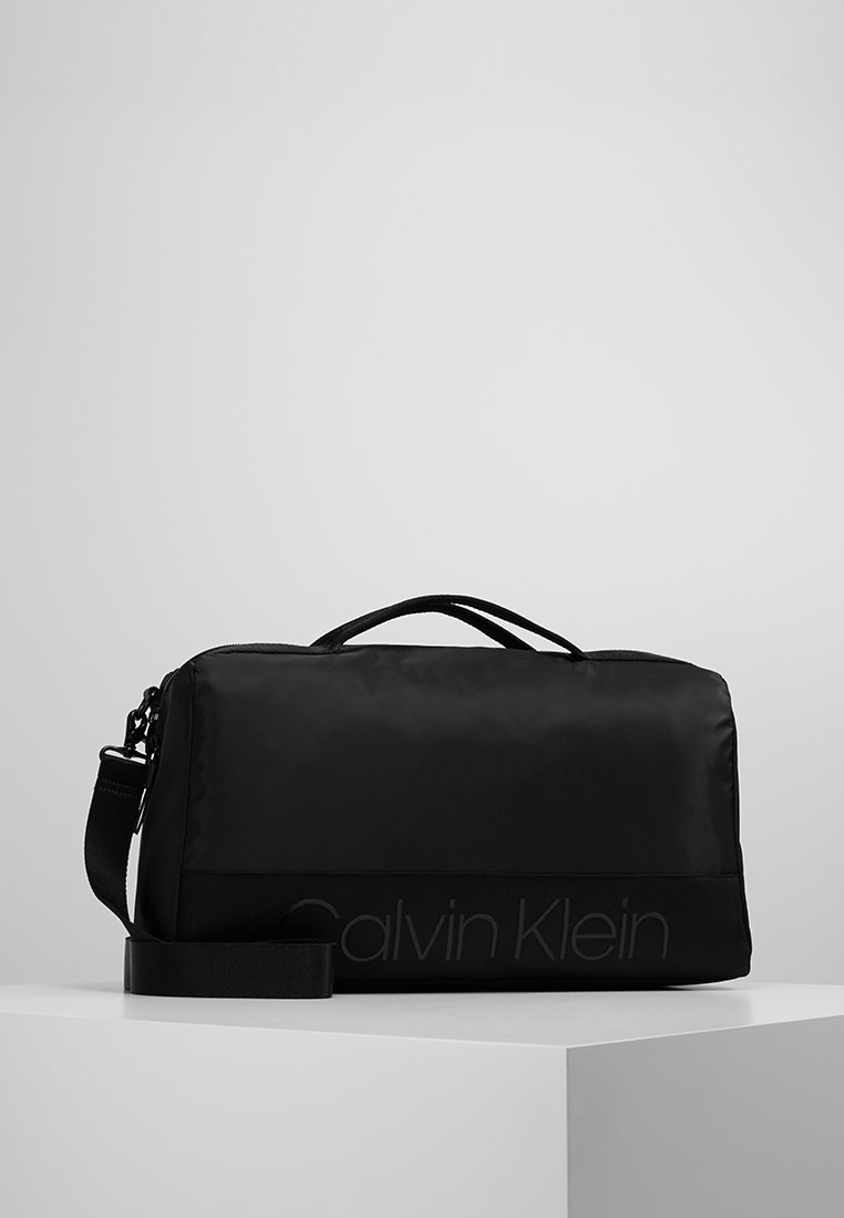 Calvin Klein - SHADOW GYM DUFFLE - Weekend bag - black