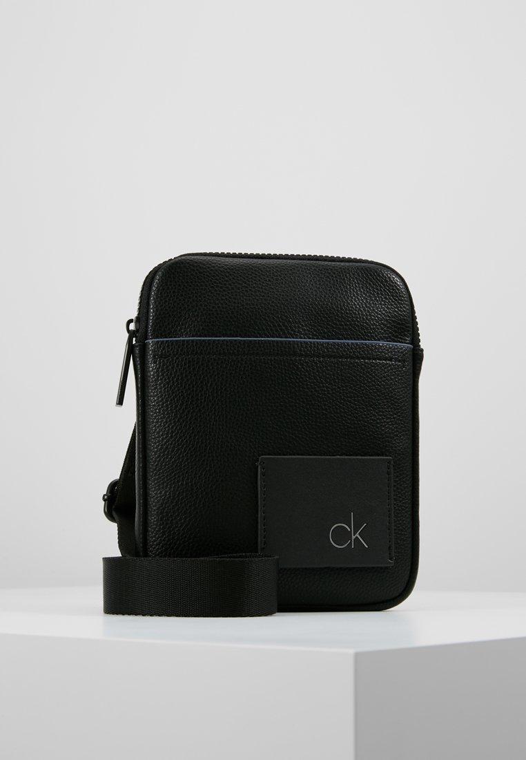 Calvin Klein - DIRECT MINI FLAT CROSSOVER - Sac bandoulière - black