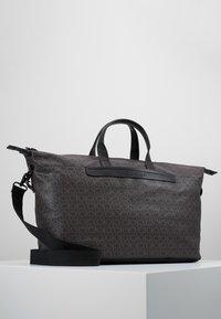 Calvin Klein - MONO WEEKENDER - Taška na víkend - brown - 5