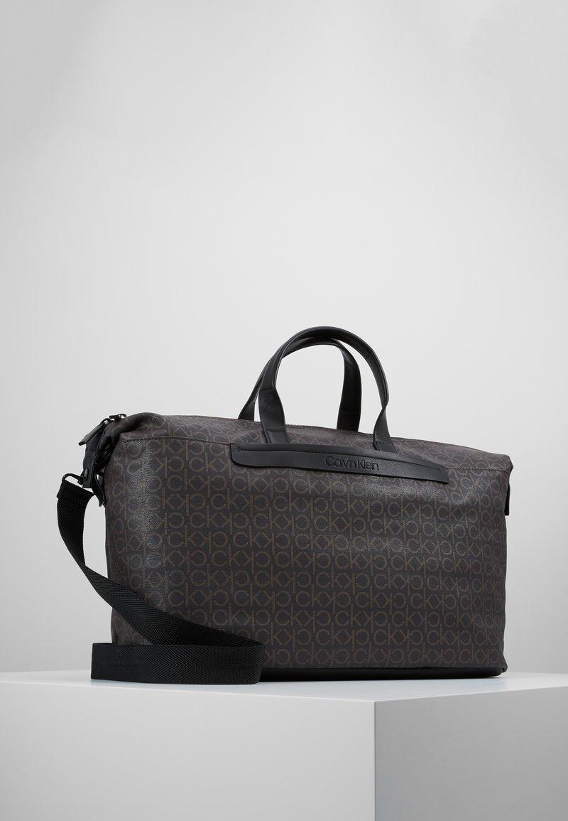 Calvin Klein - MONO WEEKENDER - Weekend bag - brown