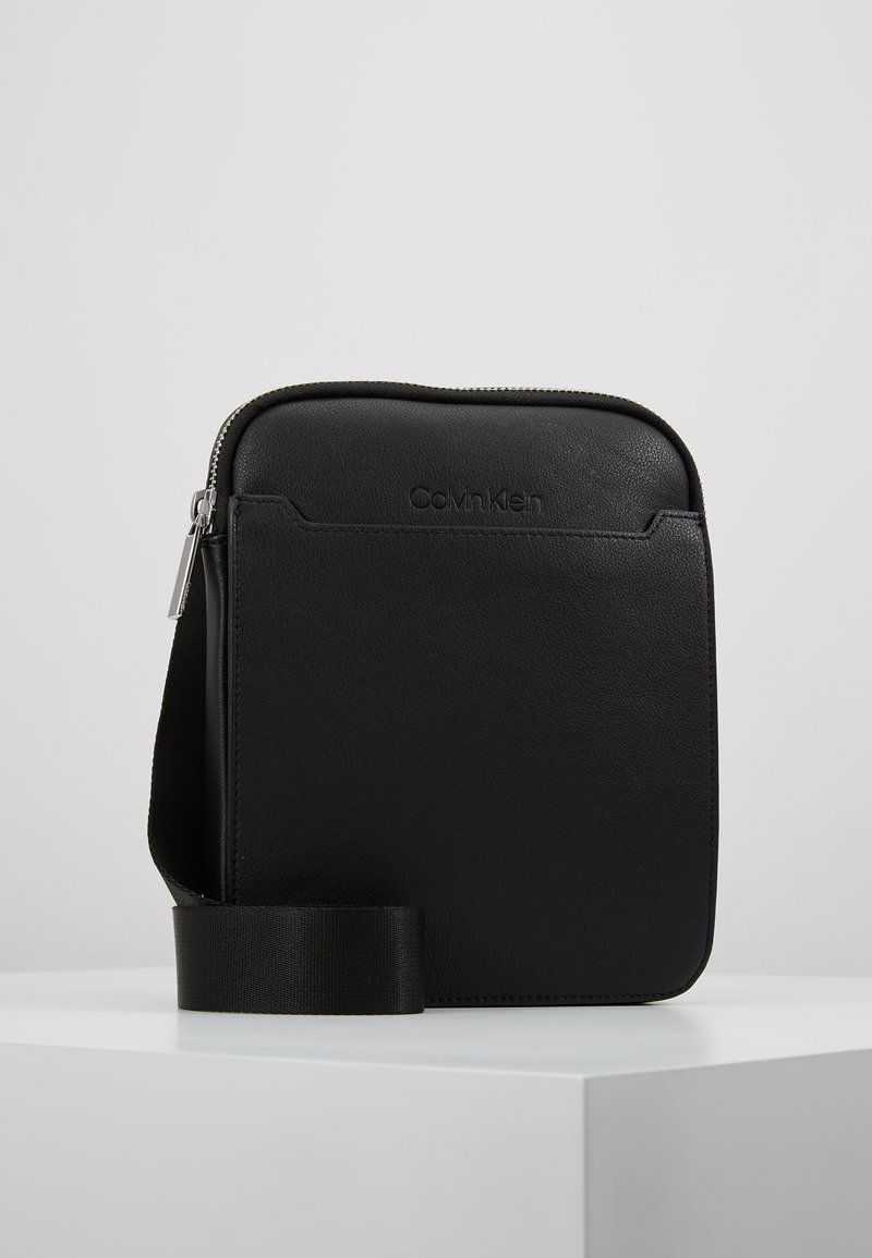 Calvin Klein - SLIVER FLAT CROSSOVER - Across body bag - black