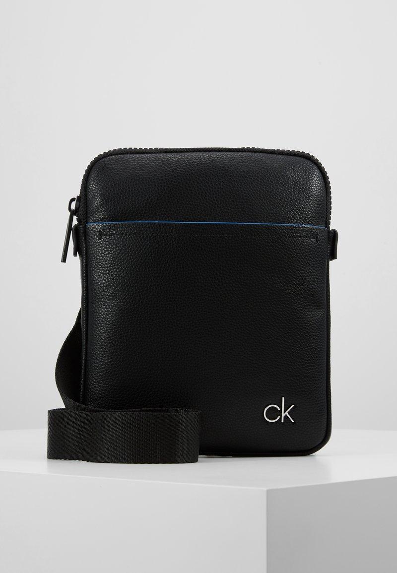 Calvin Klein - DIRECT FLAT CROSSOVER - Sac bandoulière - black