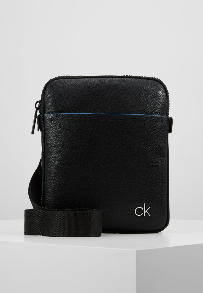 Calvin Klein - DIRECT FLAT CROSSOVER - Bandolera - black