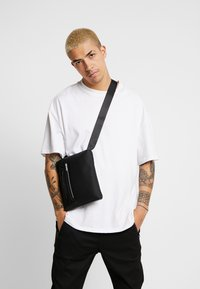 Calvin Klein - MOULDED FLAT CROSSOVER - Across body bag - black - 1