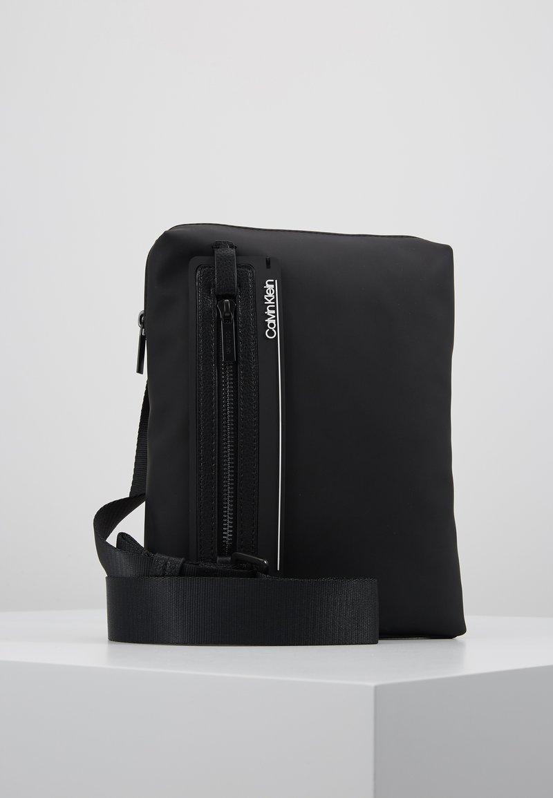Calvin Klein - MOULDED FLAT CROSSOVER - Across body bag - black