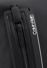 Calvin Klein - MOULDED FLAT CROSSOVER - Across body bag - black - 7