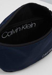 Calvin Klein - ITEM STORY WAISTBAG - Sac banane - blue - 5