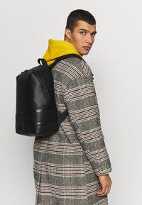 Calvin Klein - LOGO ROUND BACKPACK - Reppu - black - 1