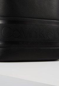 Calvin Klein - LOGO ROUND BACKPACK - Reppu - black - 6