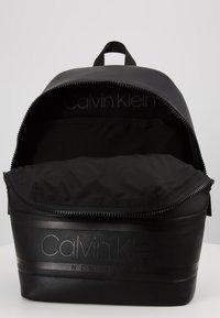 Calvin Klein - LOGO ROUND BACKPACK - Reppu - black - 4