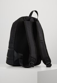 Calvin Klein - STRIPED LOGO ROUND BACKPACK - Rugzak - black - 2