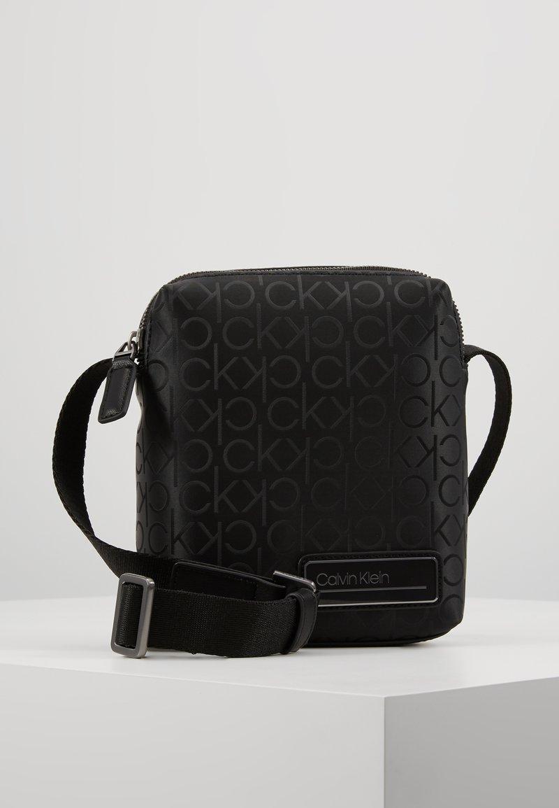 Calvin Klein - INDUSTRIAL MONO MINI REPORTER - Across body bag - black