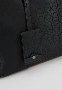 Calvin Klein - INDUSTRIAL MONO WEEKENDER - Bolsa de fin de semana - black - 8
