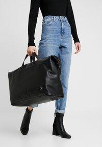 Calvin Klein - DIRECT WEEKENDER - Torba podróżna - black - 5
