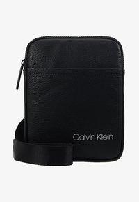 Calvin Klein - DIRECT MINI FLAT CROSSOVER - Across body bag - black - 6