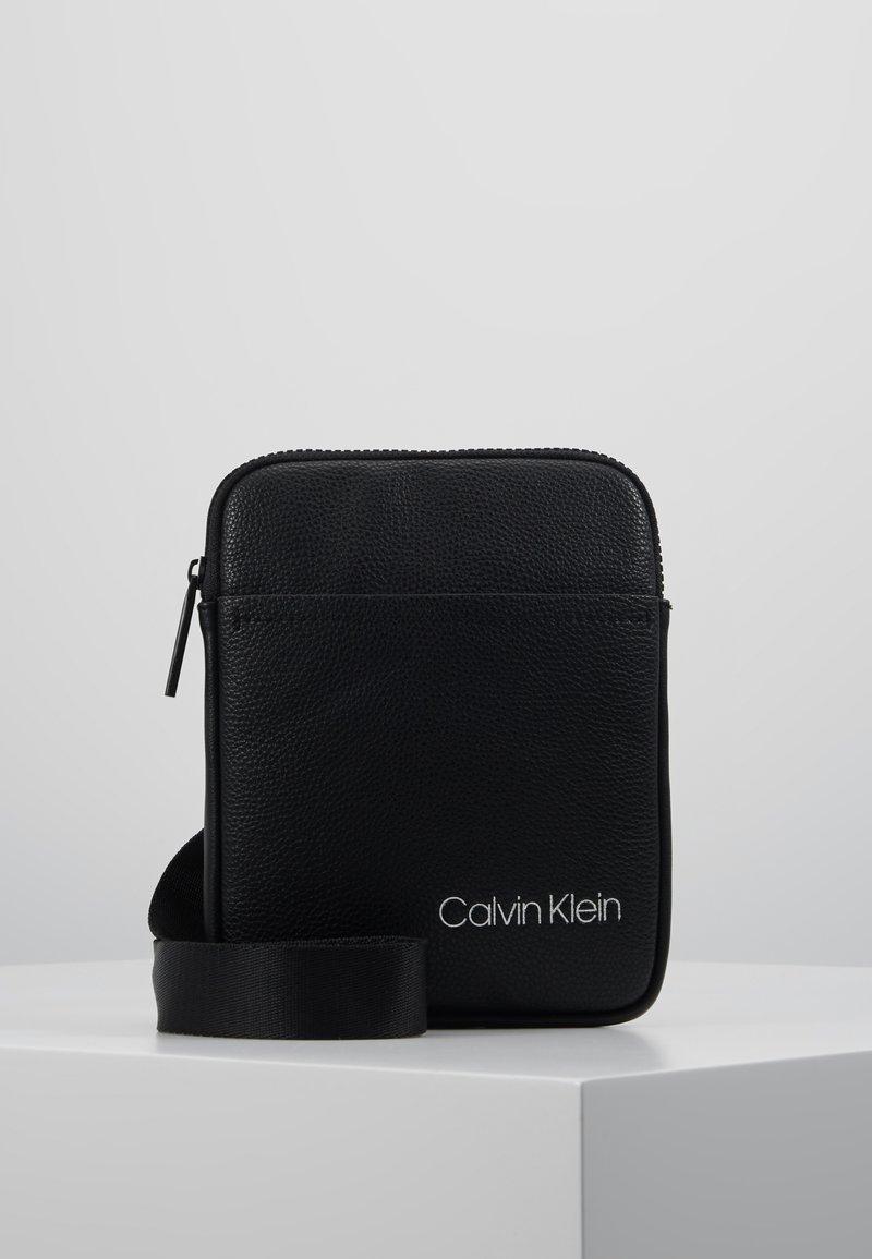 Calvin Klein - DIRECT MINI FLAT CROSSOVER - Across body bag - black