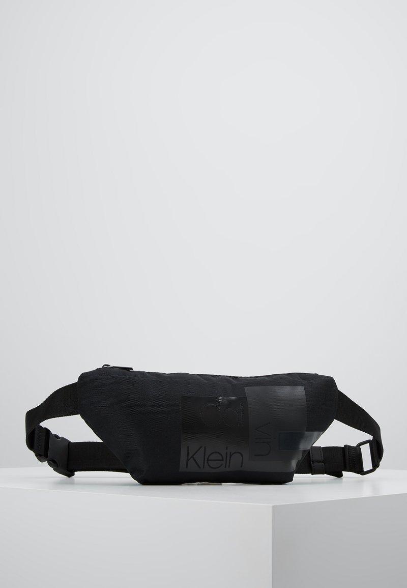 Calvin Klein - LAYERED WAISTBAG - Ledvinka - black