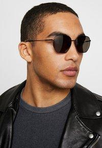 Calvin Klein - Okulary przeciwsłoneczne - black - 1