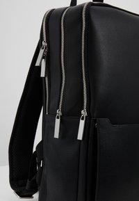 Calvin Klein - SLIVERED 3G SQUARE BACKPACK - Mochila - black - 5