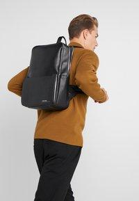 Calvin Klein - SLIVERED 3G SQUARE BACKPACK - Mochila - black - 1