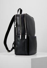 Calvin Klein - SLIVERED 3G SQUARE BACKPACK - Mochila - black - 3