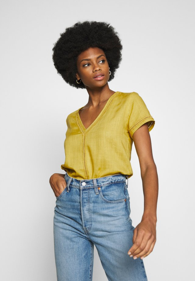 CASY PLAIN - Blouse - golden palm