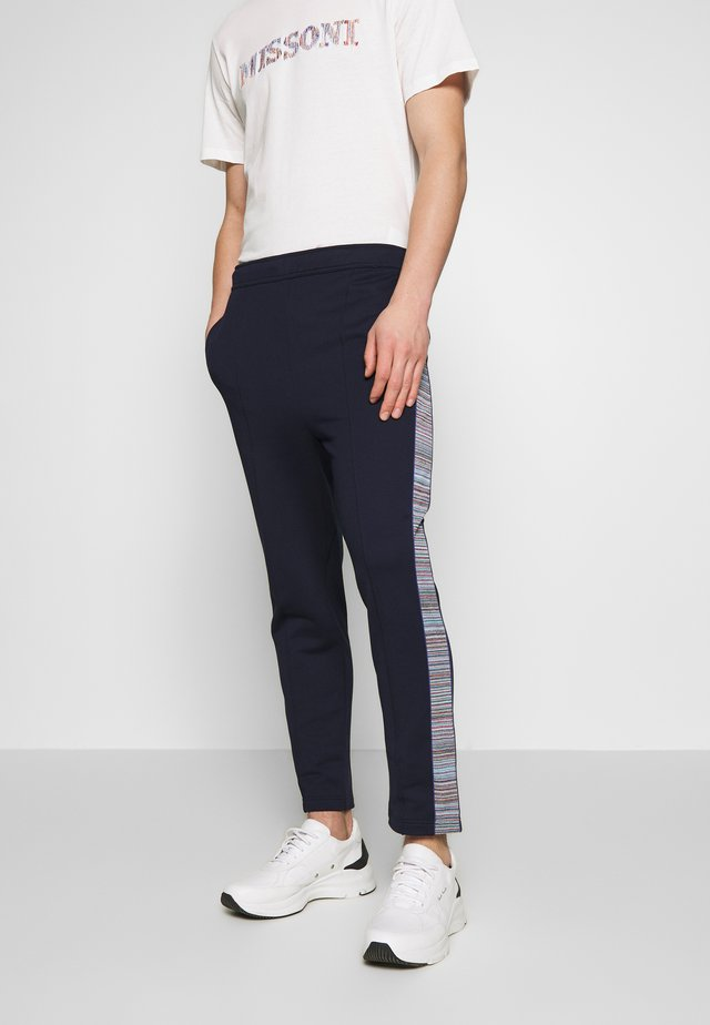 TROUSERS - Tracksuit bottoms - dark blue