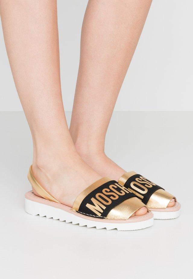 Sandały - oro