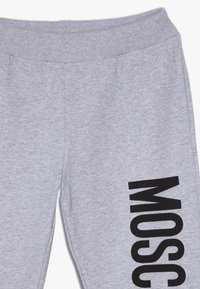 MOSCHINO - Tracksuit bottoms - grigio chiaro melange - 4