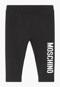 MOSCHINO - Leggings - Trousers - black - 0