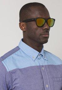 Polaroid - Sonnenbrille - black - 0