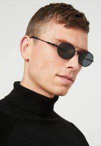 Polaroid - Gafas de sol - black - 1