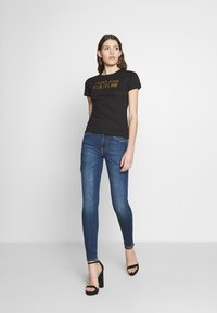 7 for all mankind - Skinny džíny - elite mid blue - 1