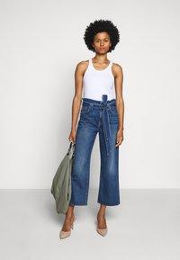 7 for all mankind - CROP ALEXA PAPERBAG  - Jeans Bootcut - dark blue - 1