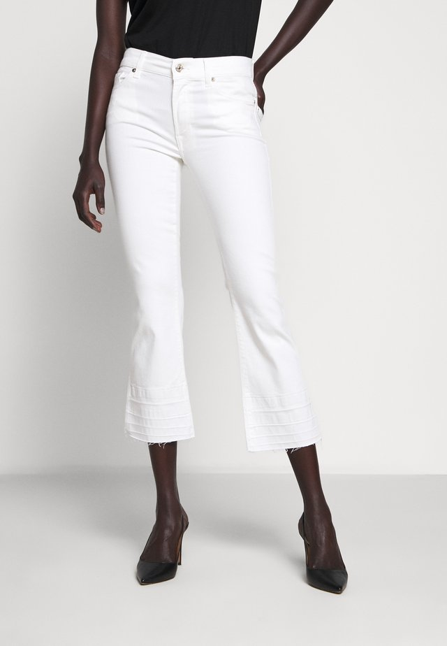 CROPPED UNROLLED - Flared Jeans - ecru