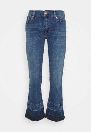 CROPPED UNROLLED - Jeans a zampa - mid blue