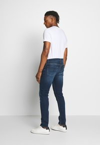 7 for all mankind - Jeans Tapered Fit - dark blue